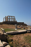 Temple Poseidon, Cape Sounion in Greece. Cape Sounion is a promontory at the southernmost tip of the Attica peninsula in Greece. Cape Sounion is noted as the Stock Photo