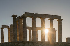 Temple of Poseidon silhouette in Sounio Greece against the sun rays. Royalty Free Stock Images