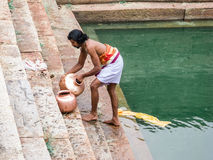 Temple Priest Washing Pots Stock Photos