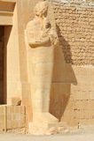 Temple of Queen Hatshepsut. Defaced Statue of Queen Hatshepsut in Ther new  kingdom mortuary temple of  at western Thebes in Egypt Stock Photo