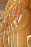 Temple of Queen Hatshepsut. Line of statues of Queen Hatshepsut at Thebes in Egypt facing east Stock Images