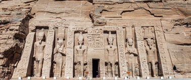 The Temple of Queen Nefertiti at Abu Simbel on the shore of Lake. Build in 1250B.C. the small temple in Abu Simbel with statues of Queen Nefertiti and Pharaoh at Stock Photos