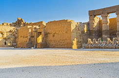 The Temple of Ramesses III. Two stone statues in front of the entrance of the Temple of Ramesses III, located in Karnak Complex, Luxor, Egypt Stock Photos