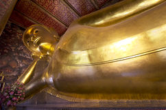 In the Temple of the Reclining Buddha in Bangkok . Stock Images