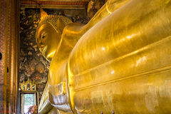 Temple of the Reclining Buddha. Reclining Buddha temple Or Temple of the Reclining Buddha is located to the north of the shrine. Wats King sat IV, please create Royalty Free Stock Photography