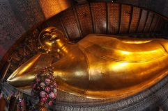Temple of the Reclining Buddha,Wat Pho, Bangkok. Golden statue of Buddha in temple Stock Photos