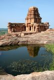 Temple and Reflection. Upper Shivalaya on top of northern hill and its reflection in water, Badami, Karnataka, India, Asia Stock Images