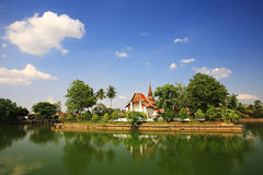 Temple with reflection on lake in Sukhothai Stock Images