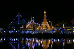 Temple with reflection on the pond and walking street night market Stock Photography