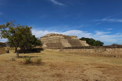 Temple remains at Monte Alban. The remains of a Zapotec temple in front of a dramatic blue sky at Monte Alban outside Oaxaca, Mexico Royalty Free Stock Image