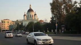 The urban traffic next to the Temple of reverend St. Sergius of Radonezh in the Rogozhskaya Sloboda, Moscow, Russia. Temple of reverend St. Sergius of Radonezh stock video