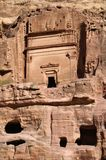 Part of the rock with an ancient religious structure. Temple in the rock. Petra, originally known as Raqmu, is a historical and archaeological city in southern Royalty Free Stock Images