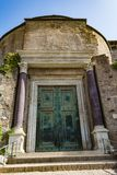 Temple of Romulus door in the Roman Forum, Rome, Italy. It`s intact because it was turned into the entrance to the Church of Saints Cosma and Damiano Stock Photography