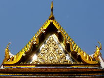 Temple Roof in Bangkok, Thailand. Ornate gold gilded temple roof in Bangkok, Thailand Stock Photography