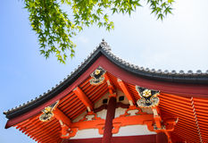 Temple roof with green  maple leaves Royalty Free Stock Image