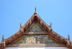 Temple Roof And Pediment. Bunsirimatayaram temple.  Roof and the pediment are magnificently  decorated with thai architectural design leaves and flowers patterns stock image