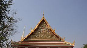 Temple Roof And The Pediment Decorated With Ornate Thai Art. Pagoda and temple.  Roof and the pediment are magnificently  decorated with thai architectural stock photo