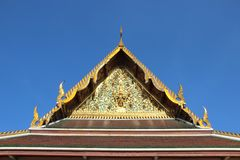 Temple Roof And The Pediment Decorated With Ornate Thai Art. Vihara in Saket temple.  Roof and the pediment are magnificently  decorated with thai architectural stock photo