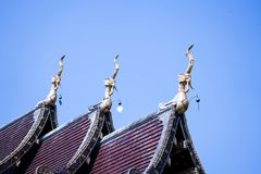 Temple roof. Thai temple architecture roof and blue sky background , copy space royalty free stock photos