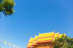 Temple Roof. Thai Temple roof under blue sky Royalty Free Stock Image