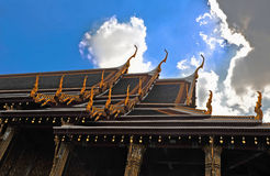 Temple roof in thailand with blue sky Stock Photo