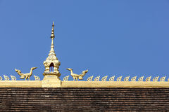 Temple Roof top on blue sky in Vientiane Province, Laos Royalty Free Stock Photos