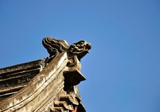 Temple Roof top Details. Chinese temple roof top details with blue sky stock images