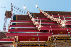 Temple roof vintage Thai style with against blue sky background Royalty Free Stock Photo