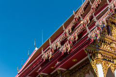 Temple roof vintage Thai style with against blue sky background Stock Photo
