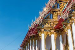 Temple roof vintage Thai style with against blue sky background Stock Images
