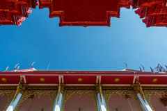 Temple roof vintage Thai style with against blue sky background Royalty Free Stock Photography