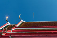 Temple roof vintage Thai style with against blue sky background Stock Photos