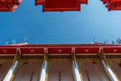 Temple roof vintage Thai style with against blue sky background Stock Photography