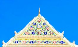 Temple rooftop decorate with naga and porcelain flower Royalty Free Stock Photography