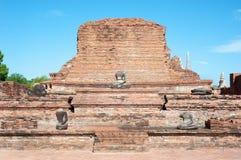 Temple ruins and damaged Buddha statue at Wat Mahathat, Ayutthaya, Thailand Stock Photo
