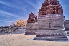 Temple ruins in Hampi under a blue sky. With wispy clouds stock photography