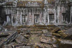 Temple ruins in the jungle walls decorated with ornaments and figures Stock Photography
