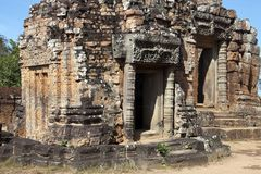 Temple ruins with ornate lintel at the 10th Century East Mebon temple. Scene around the Angkor Archaeological Park. The site contains the remains of the Royalty Free Stock Image