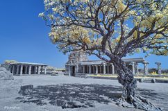 Temple in ruins under a blue sky in Hampi stock photo