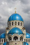 Temple. Russia. Moscow. Temple with blue domes on a background of clouds Stock Photo