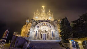 Temple of the Sacred Heart of Jesus timelapse hyperlapse on Tibidabo Mountain in Barcelona in clouds, Catalonia, Spain stock footage