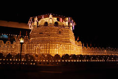 The Temple of the Sacred Tooth. The Temple of the Sacred Buddha Tooth decorated with light during national holiday Esala Perahera Royalty Free Stock Photography