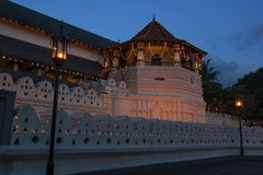The Temple of the Sacred Tooth Relic in Kandy, Sri Lanka. The sun sets over the Temple of the Sacred Tooth Relic in Kandy, Sri Lanka stock photos