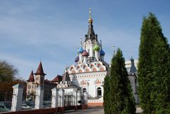 Temple in Saratov. Temple of Icon of the Mother of God Soothe My Sorrows and the building of the Saratov State Conservatory named after Leonid Sobinov (in Stock Image