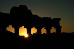 Temple of Saturn at dawn. The sun peeks through the columns of the Temple of Saturn in the Roman Forum Royalty Free Stock Photo