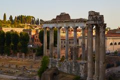Temple of Saturn in Rome. Roman forum. Columns of the temple of Saturn in the evening. Rome, Italy Royalty Free Stock Photography