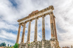 Temple of Saturn ruins in Roman Forum, Rome, Italy Stock Images