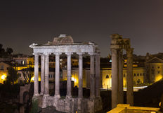 Temple of Saturn and Temple of Vespasian and Titus Stock Photos