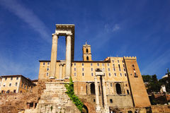 Temple of Saturn and Temple of Vespasian and Titus standing in front of the Tabularium building in the Roman Forum Royalty Free Stock Images