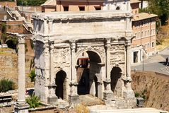 Temple of Saturn. The triumphal arch of Septimius Severus. Roman Forum, Rome, Italy. Arch of Septimius Severus at the Roman Forum Stock Images